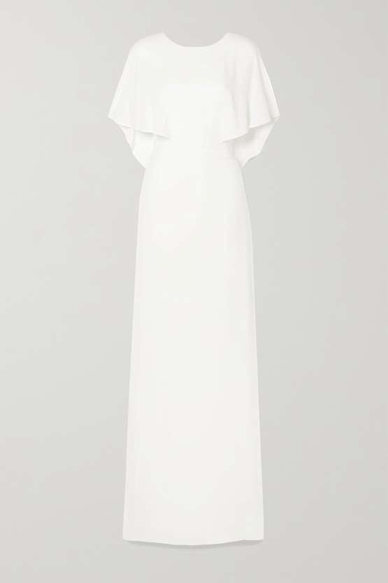 Wedding dresses with cape detail have risen in popularity over the past few seasons and it's not hard to see why – they provide a regal elegance to otherwise simple gowns. Dress,  455, Halston at Net